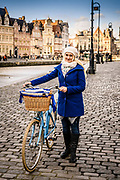 Portrait of a woman wearing the blue and white colours of the city Ghent