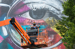 July 28, 2017 - Bristol, Bristol, UK - Bristol, UK. Upfest 2017. An artist spay paints a giant mural on the side of the Tobacco Factory for Upfest, Europe's largest street art festival held annually in Bedminster, Bristol. The festival officially runs from 29 - 31 July with over 350 artists live painting in 37 locations including this Ashton Gate stadium, home of Bristol City FC. Picture credit : Simon Chapman/LNP (Credit Image: © Simon Chapman/London News Pictures via ZUMA Wire)