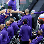 ORLANDO, FL - MARCH 24: Devin Booker #1 of the Phoenix Suns taps a teammate on the bench against the Orlando Magic at Amway Center on March 24, 2021 in Orlando, Florida. NOTE TO USER: User expressly acknowledges and agrees that, by downloading and or using this photograph, User is consenting to the terms and conditions of the Getty Images License Agreement. (Photo by Alex Menendez/Getty Images)*** Local Caption *** Devin Booker