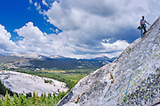 Climber on Marmot Dome with Tuolumne Meadows in background, Yosemite National Park, California