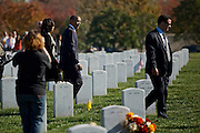 ARLINGTON, VA - NOVEMBER 11: U.S. President Barack Obama and first lady, Michelle, walk through Arlington National Cemetery after greeting family members of fallen service men and women on Veteran's Day November 11, 2012 in Arlington, Virginia.