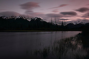 Views of the mountains across the Vermillion Lakes, just outside Banff Townsite, in Banff National Park, Alberta - long exposure shot