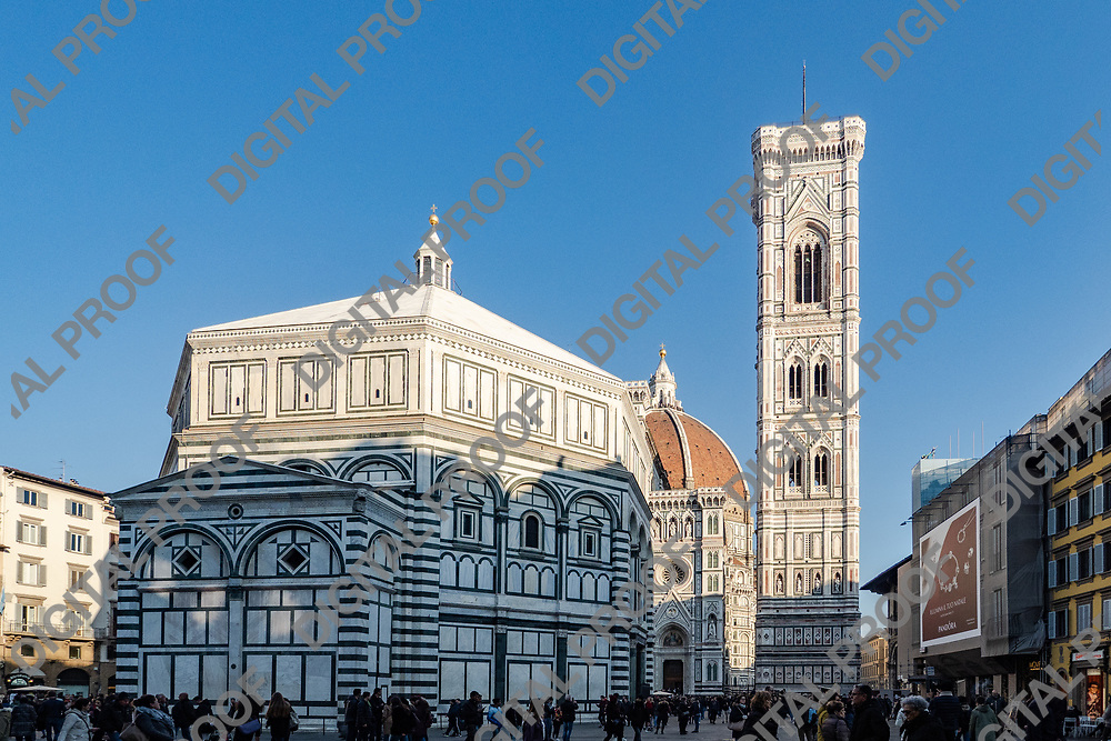 Firenze, Tuscany Italy - December 30, 2018 frontal view of St John's Baptistery, Giotto's Bell Tower and Duomo of Florence at background during the day