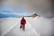 A man returns to the tour buses outside the visitor centre at North Cape (Nordkapp), ofter described as the most northerly point in Europe, in northern Norway