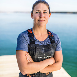 The Nature Conservancy's Brianna Group on the Jackson Estuarine Lab dock as she discusses the Supporting Oyster Aquaculture and Restoration (SOAR) program on the shores of Great Bay in Durham, New Hampshire.