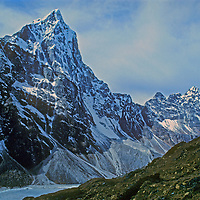 21,129-foot Cholatse Peak towers above a glacial lake in Nepal's Dzongla Valley, near Mount Everest.  Right of the frame is the Cho La Pass, which is very popular with trekkers en route to Everest Base Camp.
