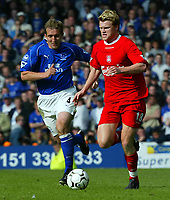 Photo Aidan Ellis.<br />Everton v Liverpool (FA Barclaycard Premiership)<br />19/04/2003.<br />Liverpool's John Arne Riise takes on Everton's Alan Stubbs