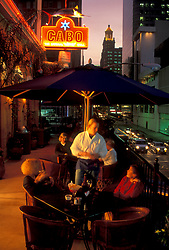Stock photo of two women sitting outside at a patio table at Cabo restaurant in downtown Houston