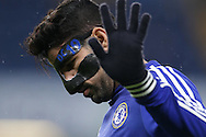Diego Costa of Chelsea wearing a face mask during the pre match warm up. Barclays Premier league match, Chelsea v Newcastle Utd at Stamford Bridge in London on Saturday 13th February 2016.<br /> pic by John Patrick Fletcher, Andrew Orchard sports photography.