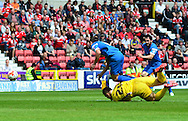 Llyoyd James being fouled for the penalty by Tyrell Belford who was sent off as a result during the Sky Bet League 1 match between Swindon Town and Leyton Orient at the County Ground, Swindon, England on 3 May 2015. Photo by Alan Franklin.