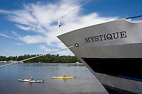 Contrast of scale between kayakers and Lady Katherine Crusie Boat on Connecticut River, Middletown, CT