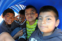 Enjoying a relaxed afternoon in the company of friends are, from right, Virgilio Hernandez, 10, Jorge Aguilar, 9, Jose Ahedo, 9, and Gustavo Aguilera, 11.