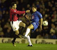 Photo. Richard Lane. <br />Birmingham City v Manchester United. Barclaycard Premiership. 04/02/2003<br />Ryan nGiggs is challenged by Matthew Upson.
