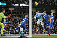 David Silva (Manchester City) heads the ball towards the goal and hits the post during the Capital One Cup semi-final match between Manchester City and Everton at the Etihad Stadium, Manchester, England on 27 January 2016. Photo by Mark P Doherty.