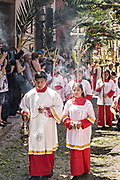 Christian believers lead a procession through the city center during Palm Sunday marking the start of Holy Week March 25, 2018 in San Miguel de Allende, Mexico. Christians commemorate the entry of Jesus into Jerusalem when it was believed that the citizens laid down palm branches in his path.