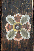 A typical Bhutanese hand painted decoration at Paro Dzong (fortress), Western Bhutan. Lhazo (painting) is one of the 'Zong Chusum' or 13 traditional arts and crafts of Bhutan. Lhazo (painting) includes painting of religious pictures, murals and frescoes in temples and dzongs as well as the colourful images on the exterior walls of Bhutanese houses.