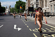 People leading the World Naked Bike Ride taking place in London. A peaceful, imaginative and fun protest against oil dependency and car culture. A celebration of the bicycle and also a celebration of the power and individuality of the human body. A symbol of the vulnerability of the cyclist in traffic. The world's biggest naked protest: 50+ cities and thousands of riders participate worldwide, including around 1500 in London.