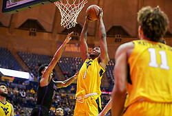 Mar 20, 2019; Morgantown, WV, USA; West Virginia Mountaineers forward Derek Culver (1) dunks the ball during the second half against the Grand Canyon Antelopes at WVU Coliseum. Mandatory Credit: Ben Queen