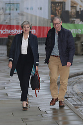 © Licensed to London News Pictures . 30/09/2017. Manchester, UK. Theresa May and Philip May arrive at the Midland Hotel ad Manchester prepares for the Conservative Party Conference , which is taking place inside a secured zone around the Manchester Central Convention Centre . Photo credit: Joel Goodman/LNP