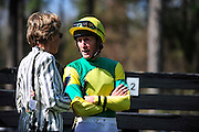 27 March 2010 : Bernie Dalton and Sue Sensor talk in the paddock before the Gr. II Carolina Cup steeplechase race. Dalton was riding Sensor's horse SUNSHINE NUMBERS.