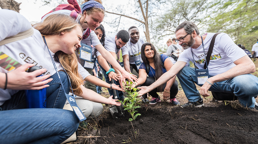 """7 March 2018, Arusha, Tanzania: On 7 March, students of GETI 2018 planted trees as part of a Service Learning day in their study programme. The trees mark a symbol of unity, and of working together for a greener planet, and a sustainable future. From 5-13 March 2018, the World Council of Churches organizes a Global Ecumenical Theological Institute (GETI) in Arusha, Tanzania, themed """"Translating the Word, Transforming the World"""". The GETI brings together young theologians from around the world for an intense academic study course in Ecumenical Missiology. GETI 2018 takes place in connection with the Conference on World Mission and Evangelism, also organized in Arusha, Tanzania."""