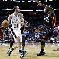 14 March 2011: San Antonio Spurs shooting guard Manu Ginobili (20) drives past Miami Heat shooting guard Dwyane Wade (3) and faces Miami Heat center Joel Anthony (50) during the Miami Heat 110-80 victory over the San Antonio Spurs at the AmericanAirlines Arena, Miami, Florida, USA.