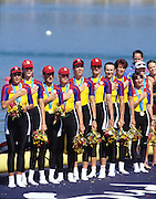 Sydney, AUSTRALIA, ROM W8+ on medal pontoon, after winning the gold medal in the women's eights, at the 2000 Olympic Regatta, Penrith Lakes. [Photo Peter Spurrier/Intersport Images]  [left to right] bow, DAMIAN, Georgeta, SUSANU Viorica, OLTEANU Ioana, COCHELEA Veronica, DUMITRACHE Maria Magdalena, LIPA Elisabeta, GAFENCU Liliana, stroke,<br /> IGNAT Doina and cox GEORGESCU Elena. 2000 Olympic Rowing Regatta00085138.tif