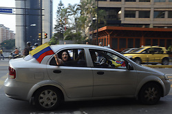 April 30, 2019 - Caracas, Miranda, Venezuela - A Guaido supporter waves a Venezuelan flag from a car. Anti-government protesters and law enforcement officers clashed in Caracas after the opposition leader Juan Guaid— called for citizens to rise up against the president. (Credit Image: © Jimmy VillaltaZUMA Wire)