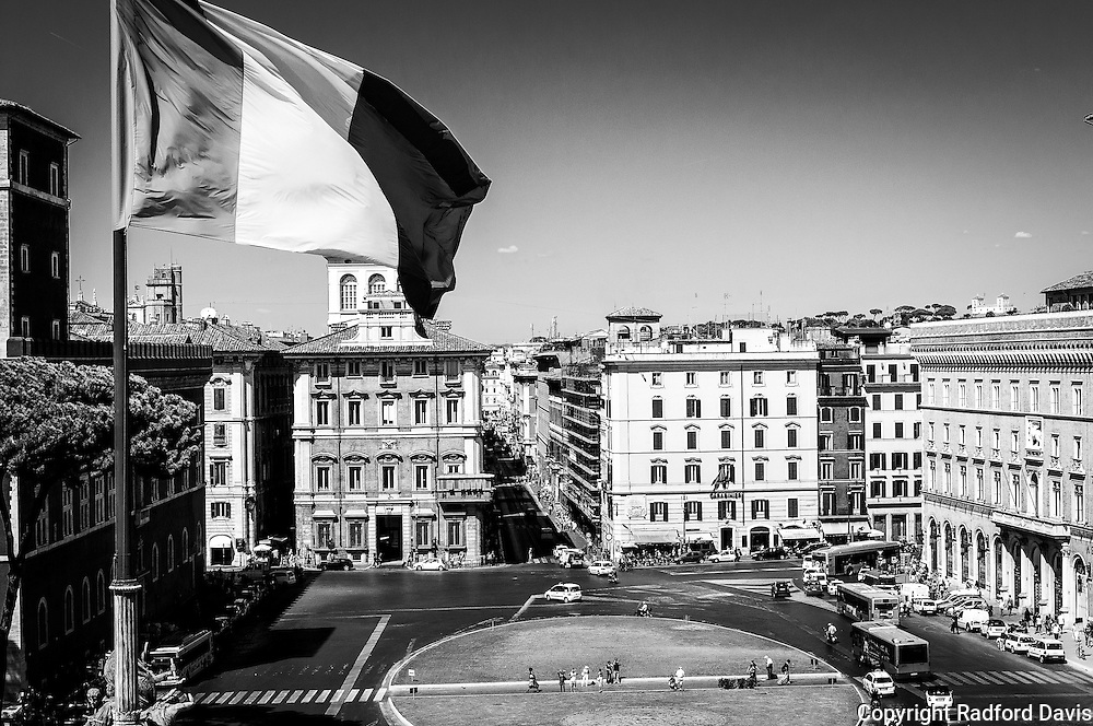 Traffic ebbs and flows around the Piazza Venezia in central Rome.