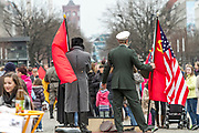 Actors pose with flags and uniforms of an American soldier and a Soviet soldier at Pariser Platz square in Berlin, Germany, April 05, 2012.