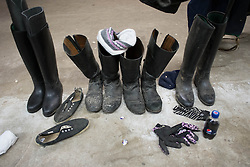© Licensed to London News Pictures. 22/03/2014<br /> <br /> Middleham, North Yorkshire<br /> <br /> Riding boots belonging to riders out exercising the race horses are lined up at the Mark Johnston stables in Middleham, North Yorkshire. Race horses have been trained in Middleham for over 200 years using the extensive gallops on the high moor. There are currently 15 stables based around the small Yorkshire village.<br /> <br /> Photo credit : Ian Forsyth/LNP