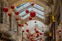 © Licensed to London News Pictures. 24/11/2020. LONDON, UK.  Christmas decorations overhead on display in Burlington Arcade in Mayfair.  The shops are currently closed and will reopen once England's lockdown restrictions are eased by the UK government after 2 December.  Photo credit: Stephen Chung/LNP