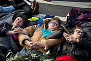 Demonstration in Parliament Square called by Extinction Rebellion to protest the government's inaction on climate change and calling for a mass rebellion and civil disobedience on 31st October 2018 in London, United Kingdom. A group of women lie in the road and wait to be arrested.