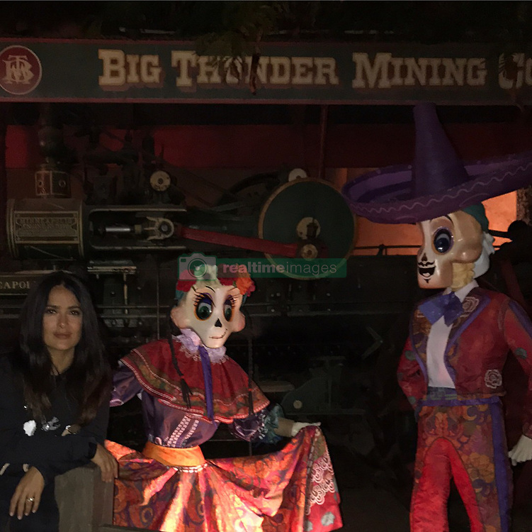 """Salma Hayek releases a photo on Instagram with the following caption: """"I love that they celebrate The Day of the Dead in Disneyland, Paris and they even sale Frida style Mickey Mouse ears.  Me encanto ver que en Disneyland Paris celebran el d\u00eda de los muertos y empiezan desde finales de Septiembre. Hasta venden orejas de Mickey estilo Frida Kahlo. #disneylandparis #eurodisney #fridakahlo #dayofthedead #diadelosmuertos"""". Photo Credit: Instagram *** No USA Distribution *** For Editorial Use Only *** Not to be Published in Books or Photo Books ***  Please note: Fees charged by the agency are for the agency's services only, and do not, nor are they intended to, convey to the user any ownership of Copyright or License in the material. The agency does not claim any ownership including but not limited to Copyright or License in the attached material. By publishing this material you expressly agree to indemnify and to hold the agency and its directors, shareholders and employees harmless from any loss, claims, damages, demands, expenses (including legal fees), or any causes of action or allegation against the agency arising out of or connected in any way with publication of the material."""