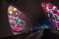 """A tunnel of nearly 2 km for pedestrians, bicycles and buses, embellished with videos and sound effects, was inaugurated on Thursday night in Lyon. <br /> The almost two-kilometre-long tunnel, which will be the largest structure in Europe dedicated to sustainable transport.<br /> At the entrance, a fresco created by children from the nearby school.<br /> 2 mins by bus, 10 minutes by bike, 20-30 minutes walk: it is the time estimated to bring the two rivers who passing under the Croix-Rousse.<br /> Concocted by the artist Skertzò, 12 sequences of 150 meters will punctuate this long tunnel of 1.7 km for """"distracting"""" the people.<br /> Projected like a movie screen outdoor, frescoes unfold to the principle of anamorphosis<br /> Open from 5am to 0:30, it was directed by Vinci Construction<br /> 2km, no restroom...<br /> <br /> Un tunnel de près de 2 km réservé aux piétons, vélos et bus, agrémenté de vidéos et effets sonores, a été inauguré jeudi soir à Lyon. Une """"première mondiale"""" selon la ville, qui dévoilait l'ouvrage la veille de la traditionnelle fête des Lumières.<br /> A l'entrée, une fresque réalisée par des enfants de l'école voisine.<br /> 2 mn en bus, 10 mn en vélo, 20 à 30 mn à pieds : c'est le temps estimé pour rallier les deux fleuves en transitant sous la Croix-Rousse.<br /> Concoctées par l'artiste Skertzò, 12 séquences de 150 mètres vont rythmer ce tunnel long de 1,7 km pour """"distraire le regard""""<br /> Projetées comme sur un écran de cinéma de plein air, les fresques se déploient selon le principe de l'anamorphose<br /> Ouvert de 5h à 0h30, il a été réalisé par Vinci Construction pour un coût  de 282,8 millions d'euros<br /> 2km, pas de WC. Au cas ou,  faut parcourir le tube en entier"""