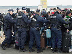 October 24, 2016 - Calais, Northern France, France - Image ¬©Licensed to i-Images Picture Agency. 24/10/2016. Calais, France. Calais Jungle Eviction. Riot police struggle to gain control as a crush develops when migrants and refugees line up to be processed and then bussed out out to reception centres across France. It is estimated that 3000 refugees and migrants to be processed. Picture by Pete Maclaine / i-Images (Credit Image: © Pete Maclaine/i-Images via ZUMA Wire)