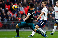 Harry Kane of Tottenham Hotspur (R) takes a shot at goal. Premier league match, Tottenham Hotspur v Southampton at Wembley Stadium in London on Boxing Day Tuesday 26th December 2017.<br /> pic by Steffan Bowen, Andrew Orchard sports photography.