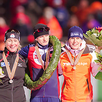 Germany's Claudia Pechstein (L), Czech Republic's Martina Sablikova (C) and Netherlands' Ireen Wuest (R) celebrate their victory on the Speed Skating All-round European Championships in Budapest, Hungary on January 8, 2012. ATTILA VOLGYI