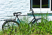 Old bicycle outside house near Ballinspittle, County Cork, Ireland