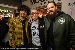 Mooneyes' Shige Suganuma with custom builders Kaichiroh Kross Kurosu of Cherry's Company and Cristian Sosa of Sosa Metal Works at the Mooneyes Area-1 afterparty for overseas guests after their Yokohama show. Monday, December 3, 2018. Photography ©2018 Michael Lichter.