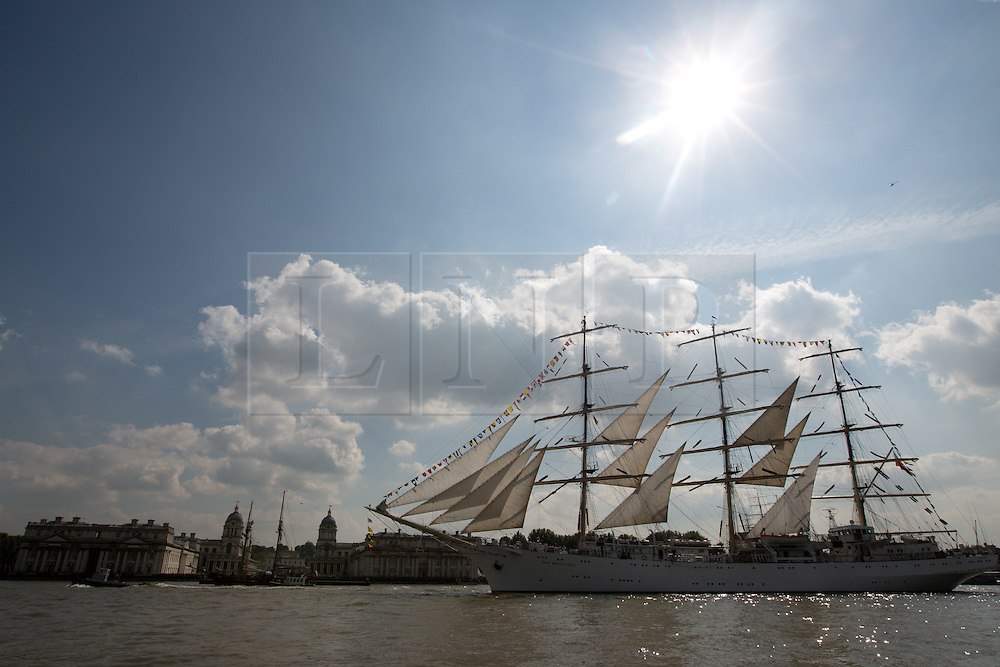 © Licensed to London News Pictures. 09/09/2014. Dar Mlodziezy passing the ORNC at Greenwich. Fifty tall ships have formed a stunning Parade of Sail down the Thames today in a dramatic and thrilling finale to the Royal Greenwich Tall Ships Festival. The ships mustered at Limehouse before moving down the Thames to the delight of onlookers, passing landmarks such as the Old Royal Naval College, the O2 and the Thames Barrier. Credit : Rob Powell/LNP