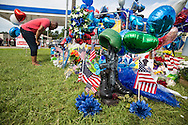 Timothy Williams, a Baton Rouge resident,  at a makeshift memorial at the site  where six officers were shot on Airline Highway in Baton Rouge. The memorial in front of the  B-Quik gas station continues to grow.