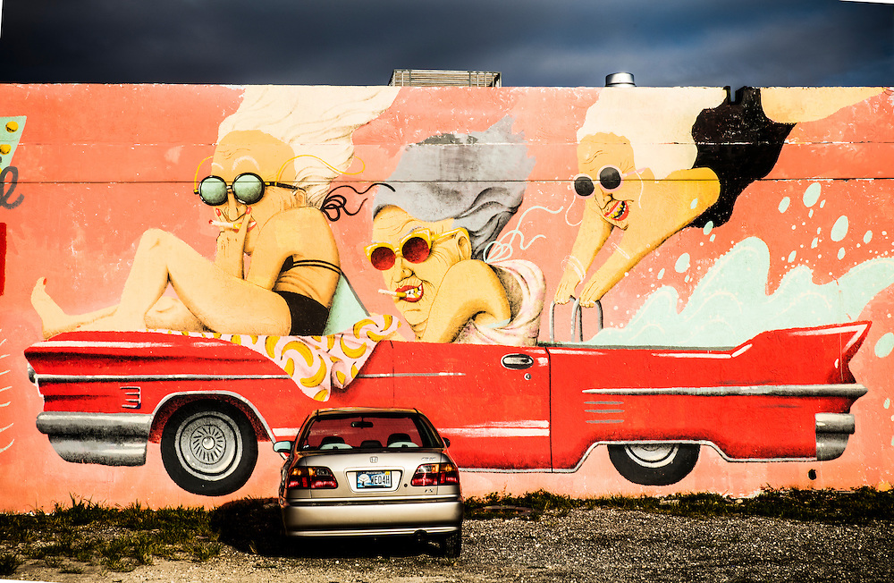 Mural in Wynwood by Barcelona-based Marina Capdevila features a coral colored Cadillac.
