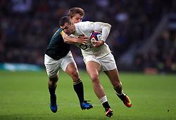South Africa's Patrick Lambie and England's Jonny May during the Autumn International match at Twickenham Stadium, London.