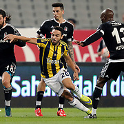 Besiktas's Olcay Sahan (L), Atiba Hutchinson (R) and Fenerbahce's Volkan Sen (C) during their Turkish Super League soccer derby match Besiktas between Fenerbahce at the Ataturk Olimpiyat stadium in Istanbul Turkey on Sunday, 27 September 2015. Photo by Kurtulus YILMAZ/TURKPIX