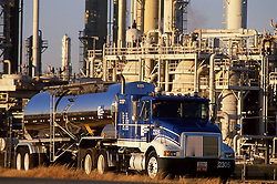 Stock photo of a large liquid transport truck parked in front of a chemical plant