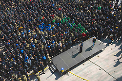 PORTSMOUTH, Va. (Aug. 17, 2018) Capt. Kyle P. Higgins, the commanding officer of the aircraft carrier USS Dwight D. Eisenhower (CVN 69) addresses the crew during an all-hands call on the flight deck. Dwight D. Eisenhower is undergoing a planned incremental availability at Norfolk Naval Shipyard during the maintenance phase of the Optimized Fleet Response Plan (OFRP). (U.S. Navy photo by Mass Communication Specialist Seaman Apprentice Conner Houghtaling/Released) 180801-N-OC881-020