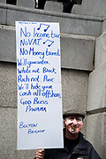 In a march organised by the Peoples Assembly, demonstrators protest  against austerity measures affecting health, education and employment, brought in by the Tory Government headed by Prime Minister David Cameron on April 16th 2016 in London, United Kingdom. Calls for Cameron's resignation followed revelations in the 'Panama Papers'. A fake David Cameron holds a sign singing the praises of Panama.