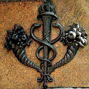 18th Century metalwork relief on the corner of a New York shopping street. The flourishing cornucopia and Greek semiology suggest Art Nouveau period décor.