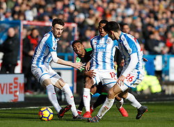 AFC Bournemouth's Jordon Ibe (behind) battles Huddersfield Town's Rajiv van La Parra for the ball during the Premier League match at the John Smith's Stadium, Huddersfield.